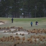 golfers_and_caddies_13th_green