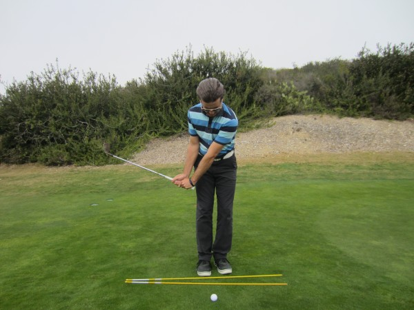 Note the Short Arm Swing, as well as the higher club head/ lower handle relationship.