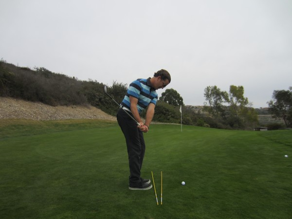 Note how the hands and handle are at thigh level while the golf club is at shoulder level.