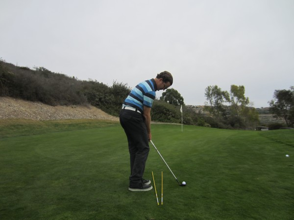 Note how much the body is turning left to help match up the path of the club to an open club face.
