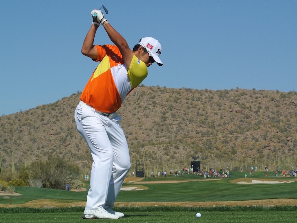 At the top of the backswing, focus on the club face (not the