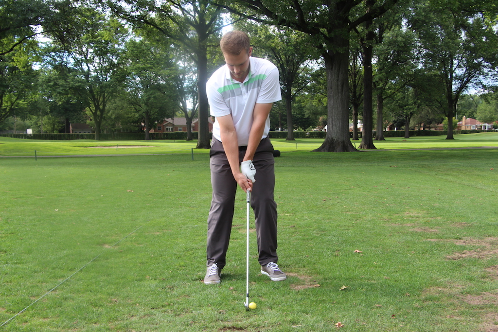 """Notice the accentuated """"cup"""" in this golfer's left wrist."""