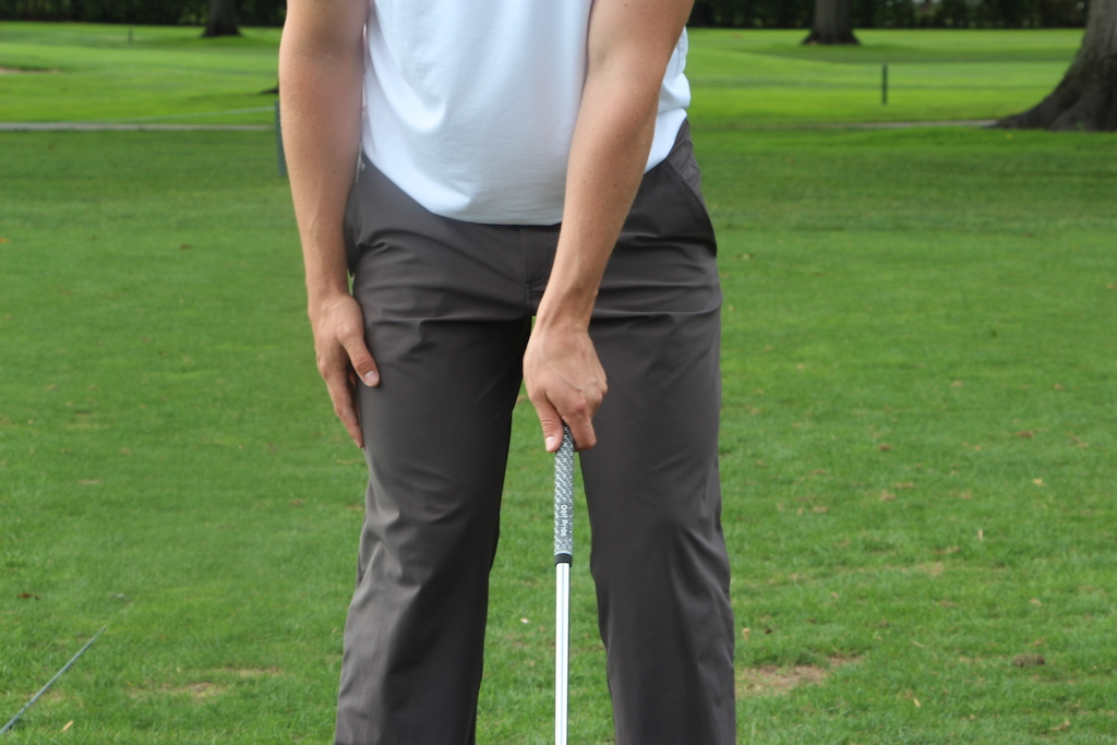 """A strong left-hand grip can create a """"blocking"""" motion at the bottom of the swing."""