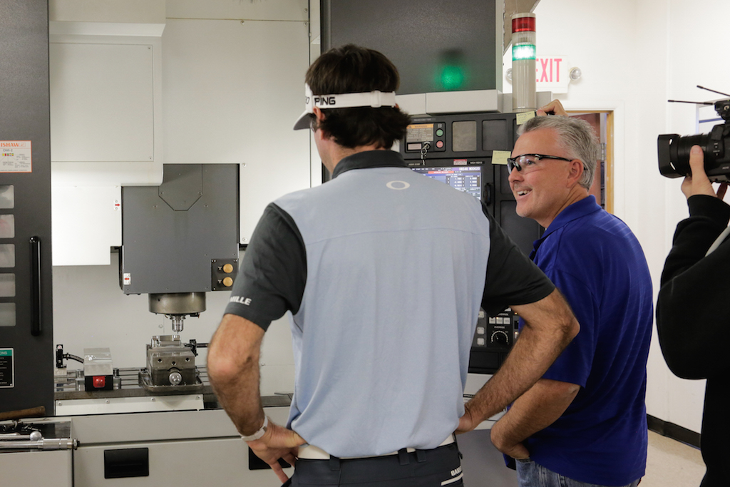 Watson watches his putter being milled to his specifications (Photo courtesy of Ping)
