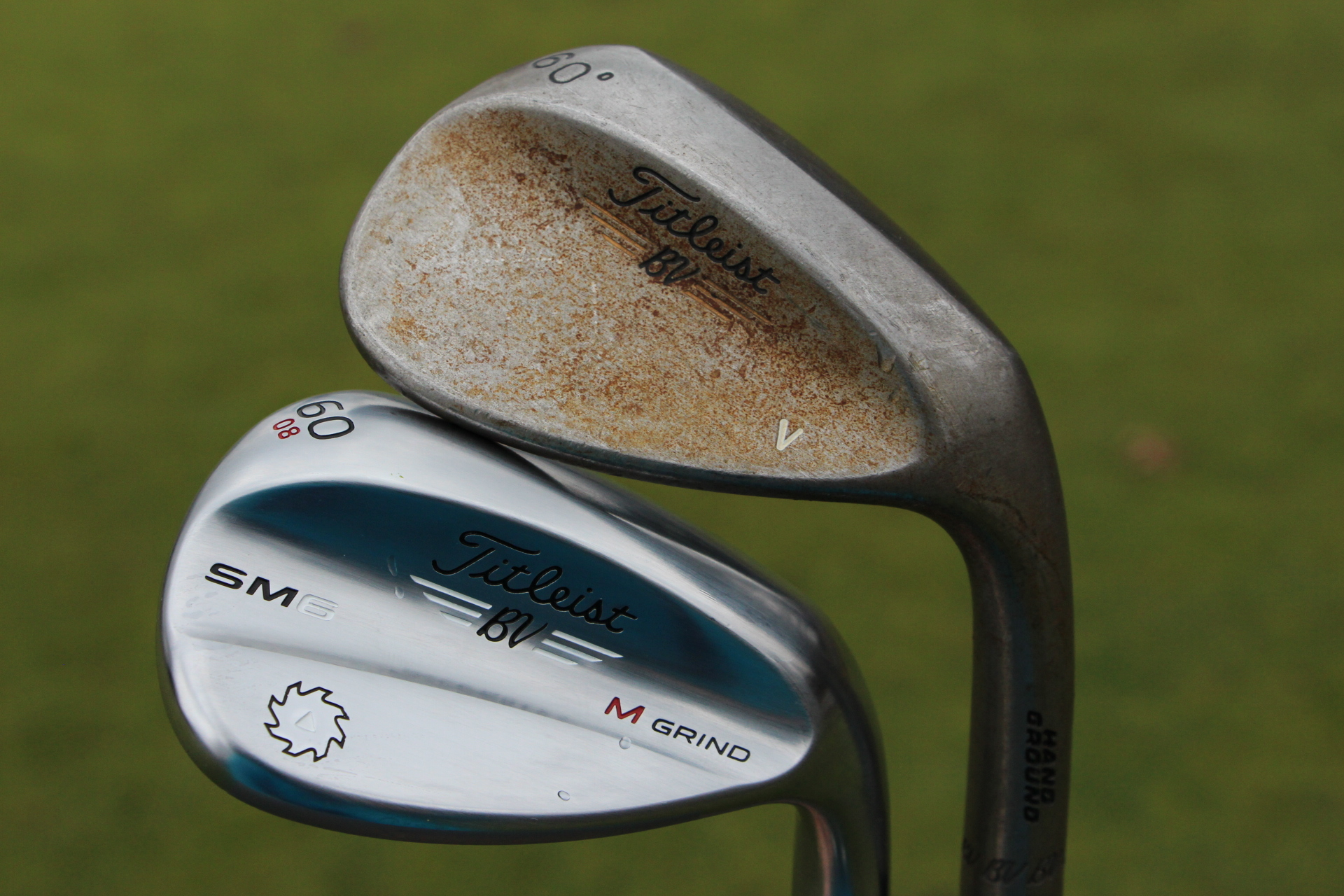 A Vokey Hand Ground wedge with a raw finish (above).
