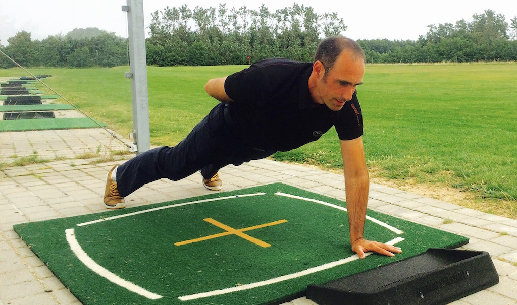Anti-rotation with a single-arm plank.