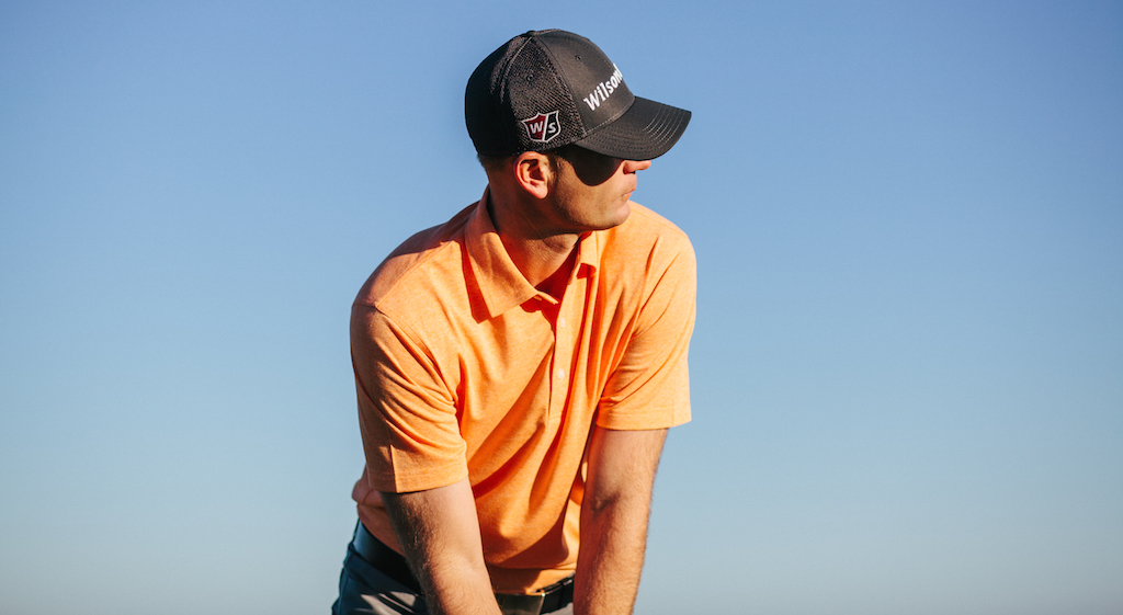"Brendan Steele wears Dunning on the PGA Tour. He's pictured in the company's ""Natural Hand"" golf shirt in ""Mid Orange Heather."" It sells for $79.99."
