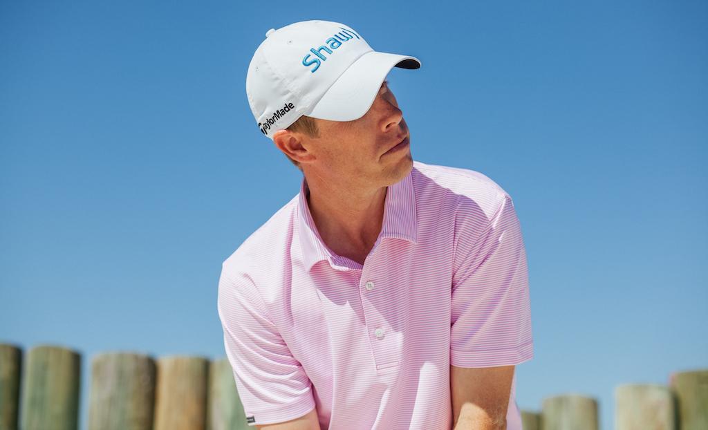 David Hearn in Dunning's Stripe Yarn Dye Jersey golf shirt ($89) in light pink/white.
