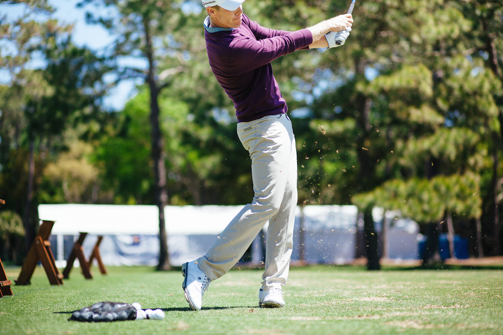 David Hearn wears Dunning on the PGA Tour. He's pictured in 5-Pocket Stretch Woven Pants ($99) in Tan and a Player Merino V-Neck sweater ($125)