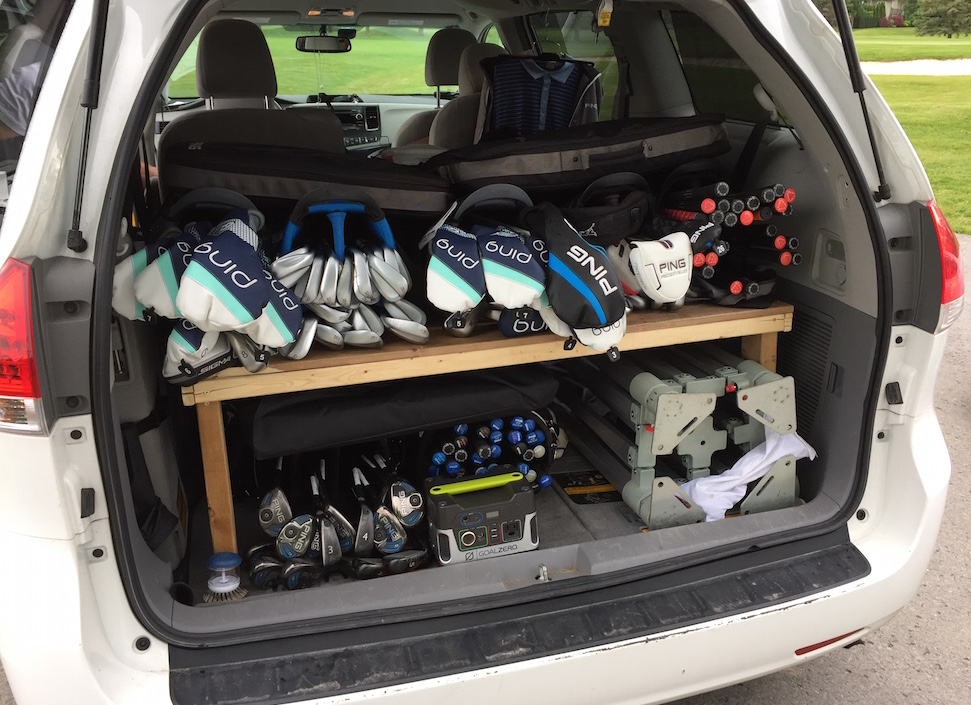 In contrast my car (cover image, this is car of a full-time Ping reps. He built a shelf for his van.