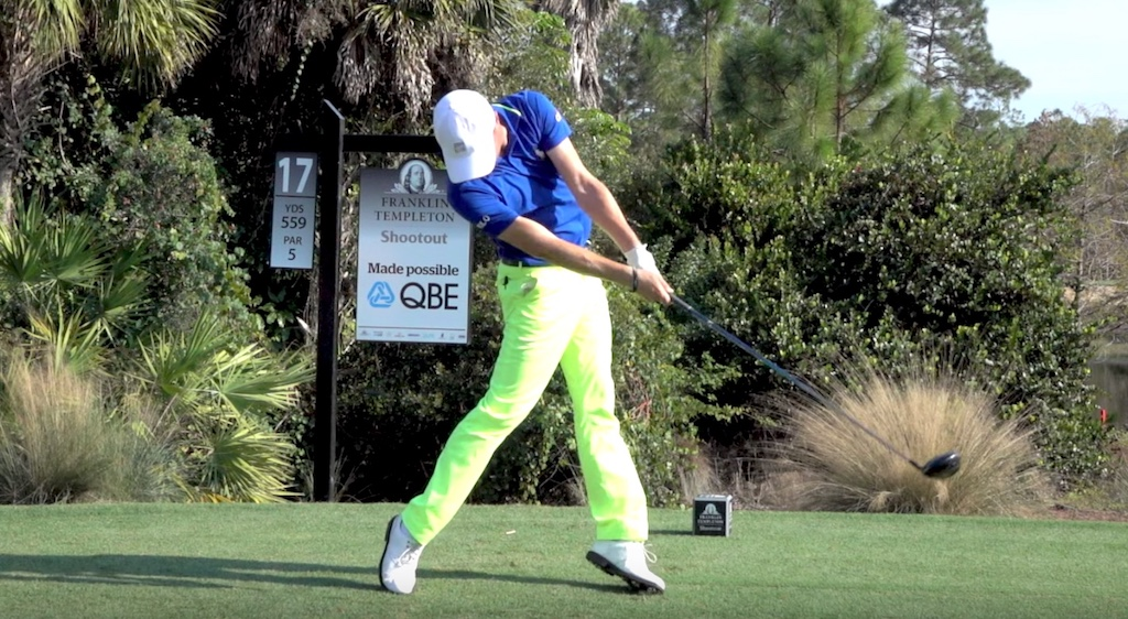Jumping off the ground can be caused by too wide of a stance and lead foot position that is too closed at setup